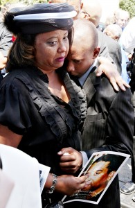 Tamara Martin, left, hugs her son, Chauncey Bailey III, 13, following the funeral for his father, Oakland Post editor Chauncey Bailey, Jr. Aug. 8, 2007, in Oakland (D. Ross Cameron/The Oakland Tribune)
