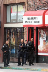 Swat teams and Oakland police officers on the scene of an early morning raid on Your Black Mulsim Bakery Aug. 3, 2007. (Laura A. Oda/The Oakland Tribune)