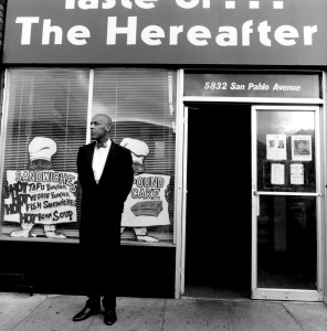 Nedir Bey supporter Basheer Fard Muhammad stands security at Your Black Muslim Bakery before its demise (Oakland Tribune file photo).