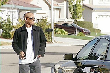 Antron Thurman walks outside the Antioch home he shares with his wife, Esperanza Johnson, who is also known as Nora Bey. (KTVU-TV)