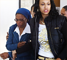 Daulet Bey, left, leaves the courthouse with a family supporter after her son, Yusuf Bey IV, is arraigned on kidnapping and robbery charges Aug. 7, 2007. (D. Ross Cameron, Oakland Tribune)