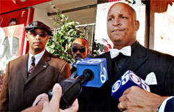Shamir Yusuf Bey, son of Yusuf Bey Sr., makes a statement to the media about the Bey family outside the closed Your Black Muslim Bakery on San Pablo Avenue in Oakland on Aug. 3, 2007. (Laura A. Oda, Oakland Tribune).