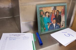 Among the items up for bid at an auction of assets from the defunct Your Black Muslim Bakery is an 8x10 framed photograph of bakery founder Yusuf Bey, Sr. with several Muslim women (D.RossCameron/OaklandTribune)