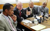 (l-r) Public Information Officer Roland A. Holmgren, Chief of Police Wayne Tucker, Asst. Chief of Police Howard Jordan, and homicide Lt. Ersie Joyner III discuss Chauncey Bailey's murder with the press Oct. 9, 2007. (Laura A. Oda/The Oakland Tribune)