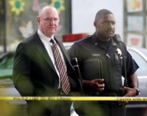 Oakland Police Chief Wayne Tucker, left, at scene of Chauncey Bailey's murder Aug. 2, 2007. (Oda/MediaNews)