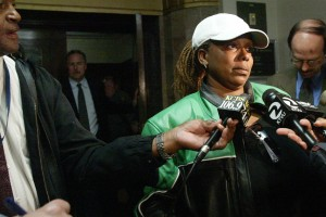 Aundra Dixon, Broussard's mother, meets press outside courtroom (Bob Butler photo)