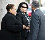Esperanza Johnson, center, following auction of the defunct Your Black Muslim Bakery, Nov. 28, 2007, in Oakland (D. Ross Cameron/The Oakland Tribune)