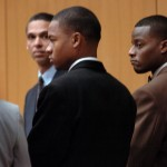 Yusuf Bey IV, center, and Kahlil Raheem, right, in court.