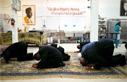 Muslims pray in the kitchen at Your Black Muslim Bakery in 2000. (Nancy Pastor, Oakland Tribune).